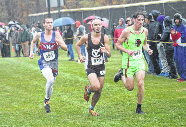 Northwest's Eli Marshall (left) competes in the Division II boys regional cross country race on Saturday at Pickerington North High School.