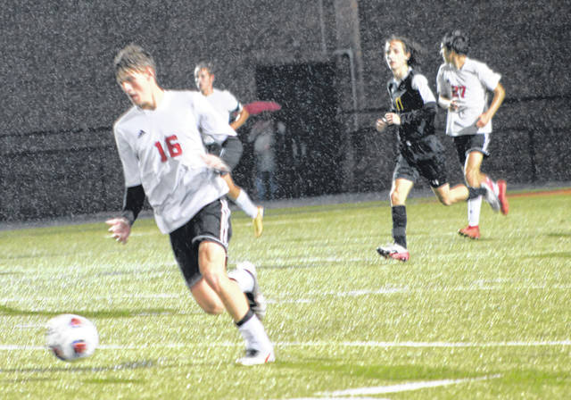 South Webster's Aiden Andrews (16) picks up possession of the ball during the Jeeps' Division III boys soccer regional semifinal match against Lynchburg-Clay on Wednesday night at Waverly's Raidiger Field.