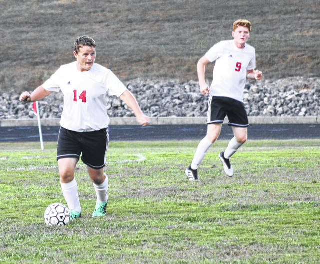 South Webster's Stephen Smith (14) and Brice Robnett compete (9) for the Jeeps against Minford during a match earlier this season.
