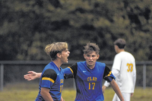 Clay's Bryce Toomire (left) and Dylan Collett (right) celebrate one of Toomire's two goals in Tuesday's win over Ironton St. Joe.