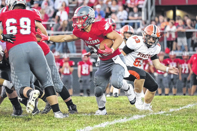 Minford senior running back Ty Wiget with a first half carry during the Falcons home SOC II opener with Wheelersburg Friday.