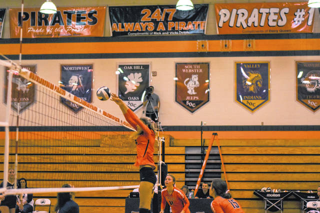 Wheelersburg junior Kylee Barney with one of her 10 blocks during the Pirates home non-league wins over Notre Dame Wednesday.