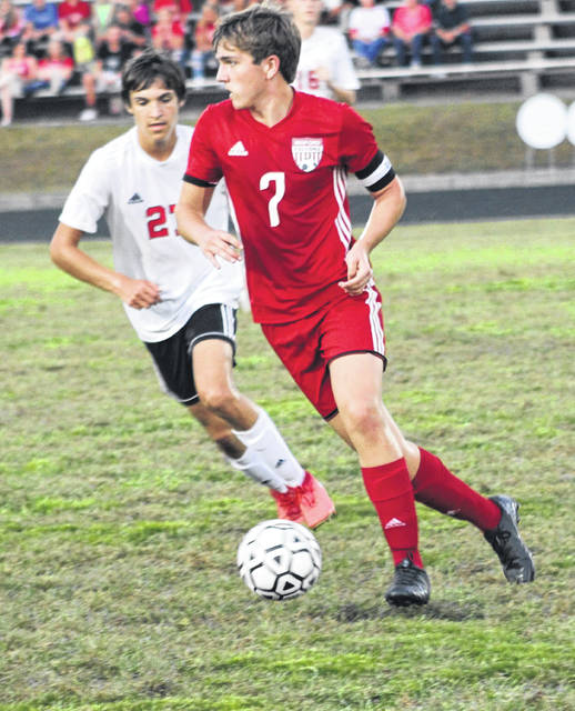 Minford senior Adam Cordle (7) looks to pass the ball as South Webster's Tryston Robinson (27) defends during Thursday night's Southern Ohio Conference Division II boys soccer match at Minford High School.