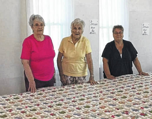 <em><strong>The Vernon Senior Over 55 Club</strong></em> will hold it's annual Fall Festival on Saturday, October 26, from 11 AM until ??? There will be food - beans, cornbread, and hot dogs, desserts, and drinks. A quilt will be raffled along with lots of door prizes. Everyone is welcome. For more information, call 740-574-2690. Some of the ladies who worked on the quilt include left to right: Carole Powell, Eileen Crawford, and Sandy Ramey.