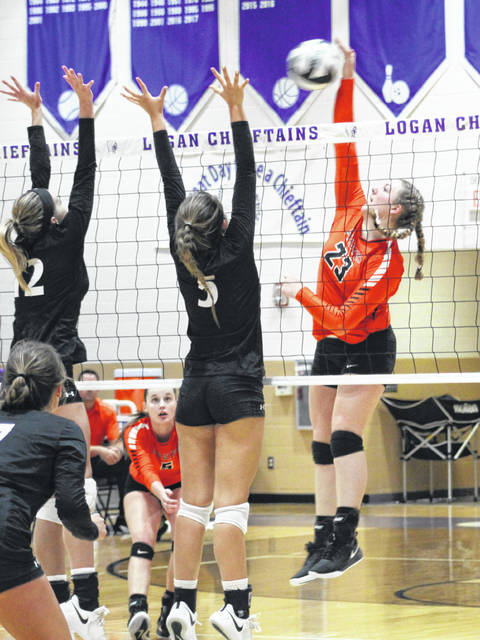 Wheelersburg's Ryleigh Meeker (23) goes up for a kill during the Lady Pirates' Division III regional championship volleyball match against Hiland on Saturday at Logan High School.