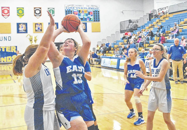 East sophomore Felicia Smith attempts a shot near the basket during the Tartans non-league loss to Ripley Saturday at the Manchester Tip-Off Classic.