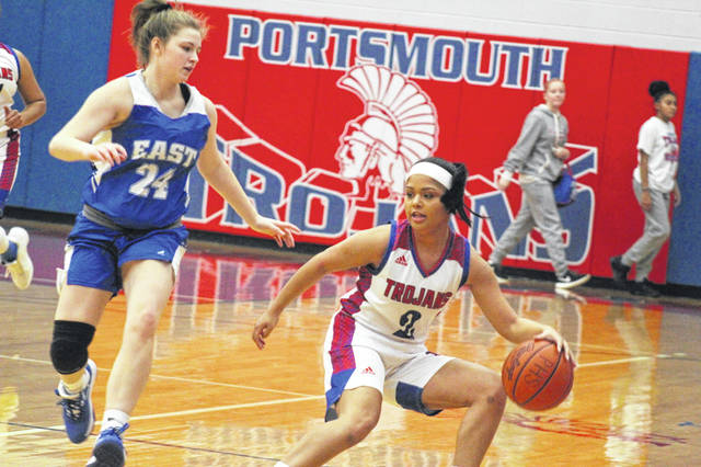 Portsmouth's Nia Trinadad handles the ball against the defense of East's Kacie Conley during their non-league game, Monday.