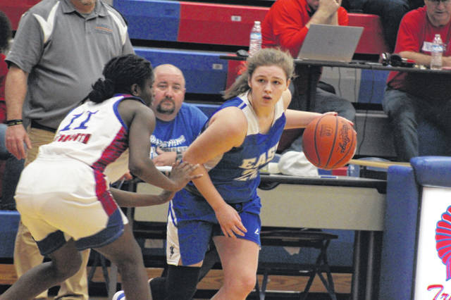 East sophomore Kacie Conley handles the ball during the Tartans road loss to Portsmouth, Monday.
