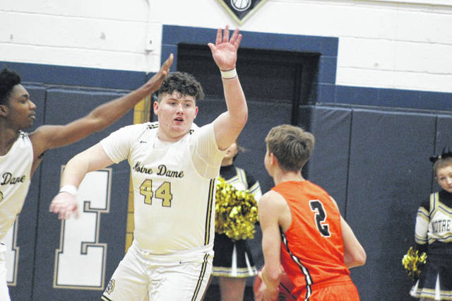 Notre Dame sophomore Jarren Edgington (44) contests a shot during the Titans' 51-41 home loss to West, Friday.