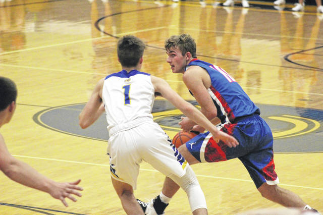 Northwest senior Timmy Emmons drives against Clay junior Clay Cottle during the Panthers' 64-50 win over the Mohawks, Saturday.