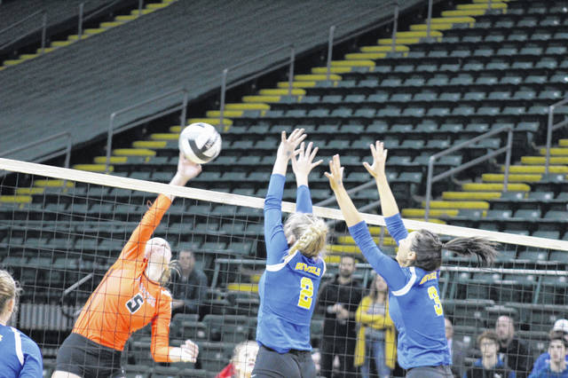 Wheelersburg senior and first team all-Ohio hitter Alli McQuay attempts a hit vs. Independence's Callie Prokopius and Kalli Screptock during their Division III state semifinal match at Wright State University's Nutter Center.