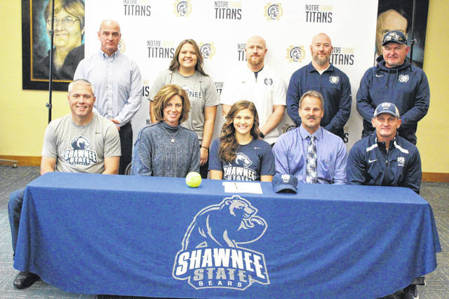 Notre Dame senior Cassie Schaefer (center) is pictured with family and coaches at her signing ceremony with Shawnee State University softball Tuesday morning at Notre Dame High School.