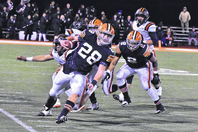 Ironton's Reid Carrico (28) carries the ball and stays inbounds en route to a 55-yard first-quarter touchdown run in the Fighting Tigers' 24-14 victory over Ridgewood in the Division V Region 19 championship on Saturday night at Nelsonville-York's Boston Field.
