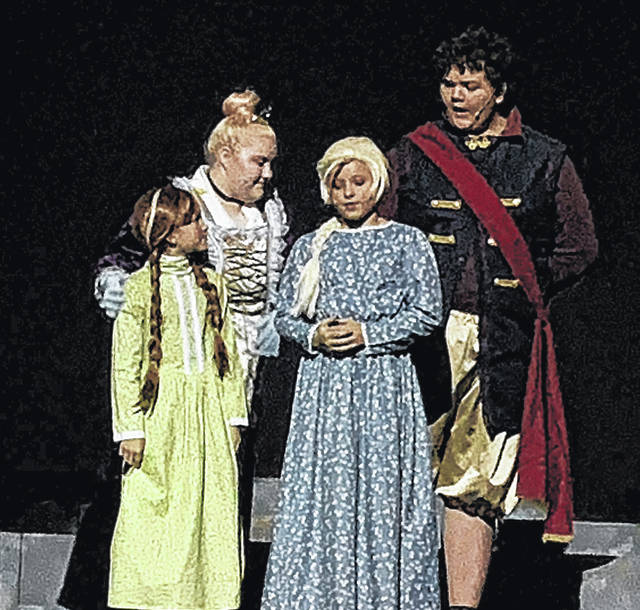 The king(Andrew Sessor) and queen(Jaylynn Hoskins) with a young Elsa(Ella Thompson) and Anna(Bentlee Dowdy)