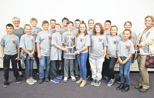 <em>West Middle School Winning Quiz Bowl Team — Front Row L to R: Ethan Doughman, Laiken Caudill, Evan Stiles, Ethan Patton, Tyson McGinnis, Kylee McCleese, Joel Roush, Vacilya Begley, Camilla Harrison. Back Row L to R: Assistant Coach Erin Ballengee, Owen Rawlins, Corbin Miller, Elijah Kasper, Logan Ralstin, Charlie Pollitt, Max Bell, Rylee Fuller, Coach Lisa Montgomery</em>