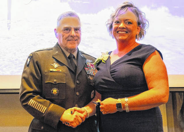 South Central Ohio Educational Service Center Superintendent Sandy Mers received the Community Leader of the Year Award from the Chairman of the Joint Chiefs of Staff Gen. Mark Milley in Washington, D.C., on Oct. 24, for her work with Wear Blue: Run to Remember.