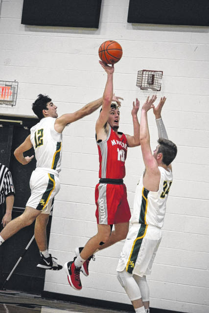 Minford senior Nathan McCormick puts up a floater during the Falcons road season-opening win over North Adams, Friday.
