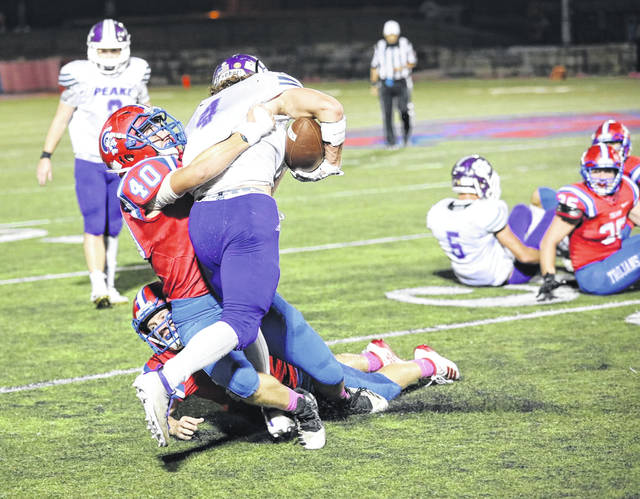 Portsmouth's Ty Pendleton (40) tackles Chesapeake's Will Todd (4) during their Ohio Valley Conference football game earlier this season at Portsmouth High School's Trojan Coliseum.