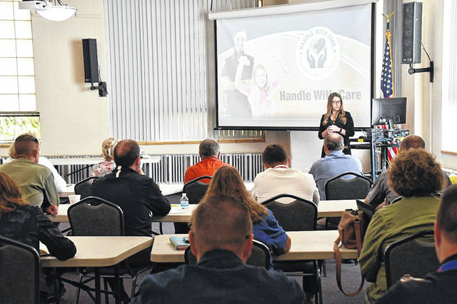 Community partners gathered at the South Central Ohio Educational Service Center, in New Boston, on Oct. 22, to receive information about the Handle with Care program to identify and help students after a traumatic event.