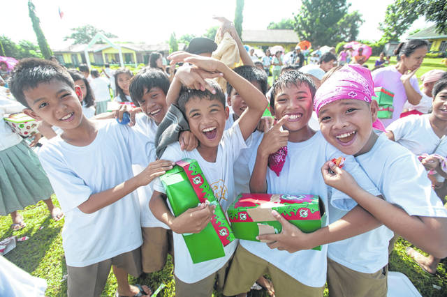 The smiling faces of the children when they receive their shoeboxes