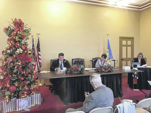 Commissioners Davis and Coleman hold first meeting in new meeting space.