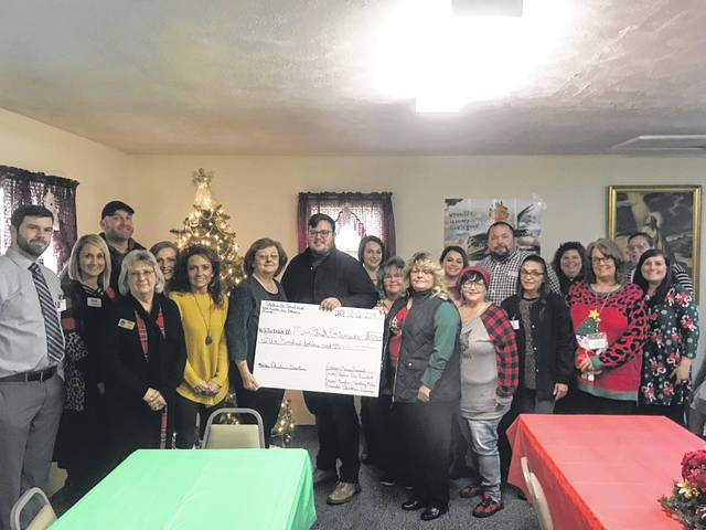 Southern Ohio Social Work Association and Health Care Alliance members present check to Joseph Pratt (Middle).