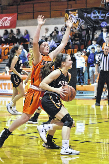 Wheelersburg's Ellie Kallner is defended by Ironton's Kirsten Williams (22) during Monday night's non-league girls basketball game at Ironton High School's Conley Center.