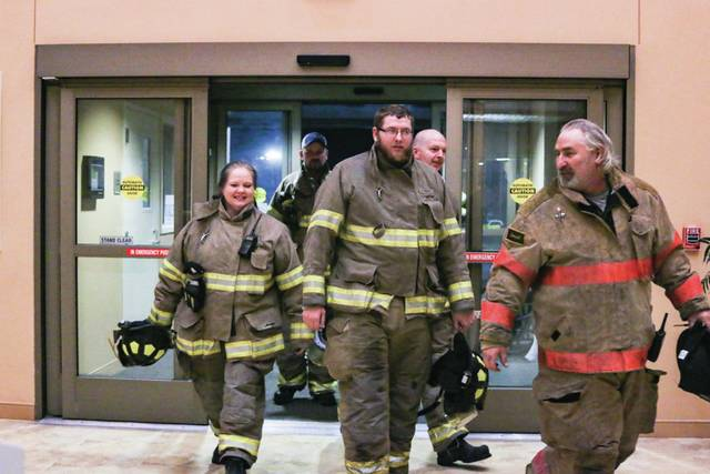 Members of the Firebrick Fire Department march into SOMC to see Michelle Stump, a member of the Firebrick Auxillary Women's Club.