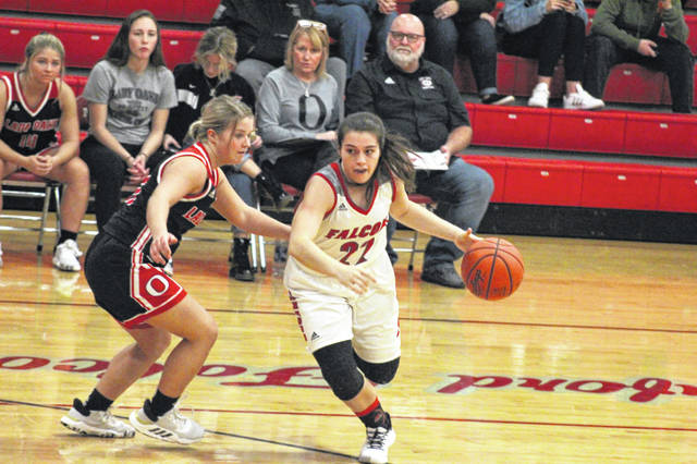 Minford senior Maddie Slusher with a drive during the Lady Falcons home loss to Oak Hill, Monday.