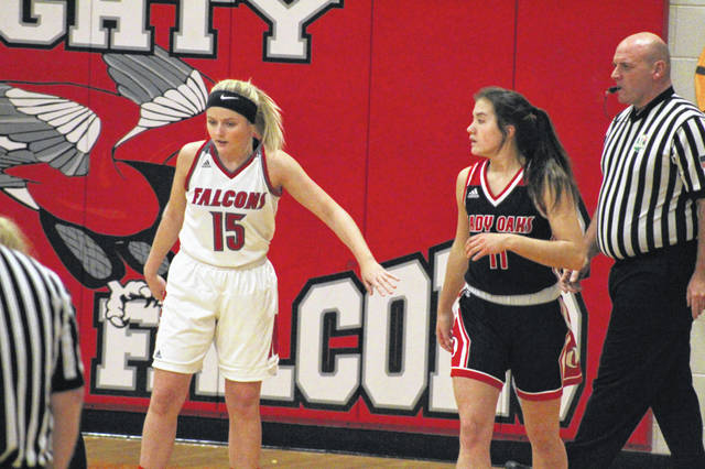 Minford junior Livi Shonkwiler (15) defends Oak Hill senior Caitlyn Brisker (11) during their SOC Division II girls basketball game Monday in Minford.