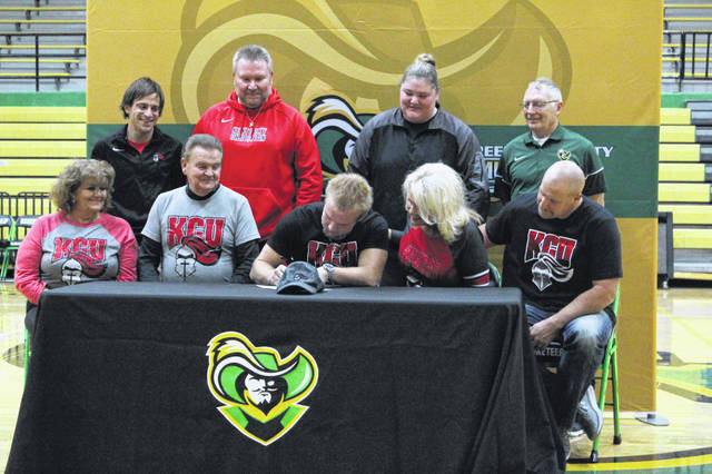 Greenup County senior Tanner Euton (center) signed his letter of intent to join the Kentucky Christian University track and field team Wednesday at a signing ceremony at GCHS. During his field career at GC, Euton has set personal record of 107-11 in discus at the 2019 KHSAA 2A Region 6 Meet and a personal record of 37-9.5 in shot put after beginning his field career his junior season. Euton plans to become a business major upon enrolling at Kentucky Christian.