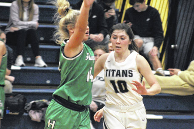 Notre Dame senior all-Southeast District guard and defensive specialiast Olivia Smith was tasked with defending Huntington sophomore Allison Basye during the Titans 65-38 win over the Huntsmen on Saturday.