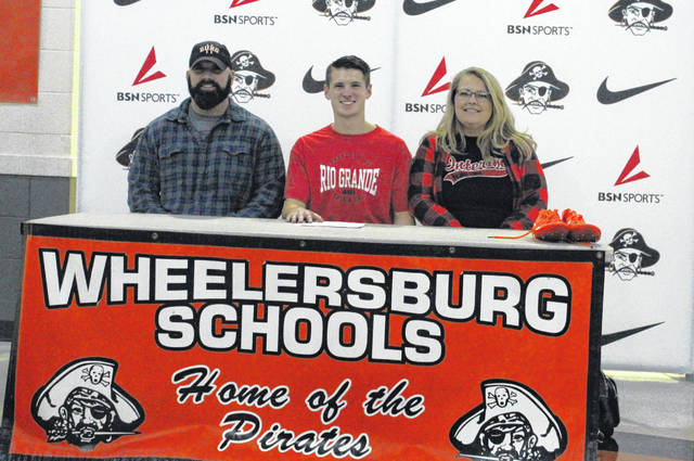 Wheelersburg senior Zach Whitley (center) signed his letter of intent on Friday, December 13th to run track and field as well as cross country for the University of Rio Grande RedStorm.