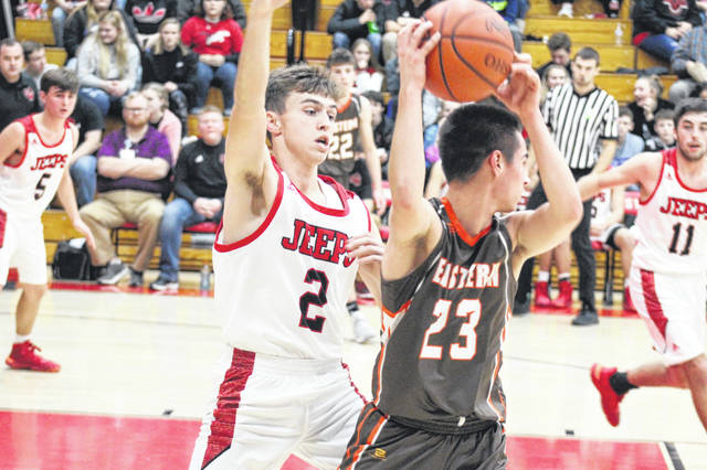 South Webster sophomore Trae Zimmerman (2) defends Eastern sophomore Brennen Slusher (23) in the first half of the Jeeps' home loss to the Eagles on Tuesday.