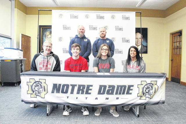 Notre Dame senior Lauren Campbell (center right) signed her letter of intent on Friday to join the women's basketball team at Ohio Wesleyan University beginning in the 2020-21 season.