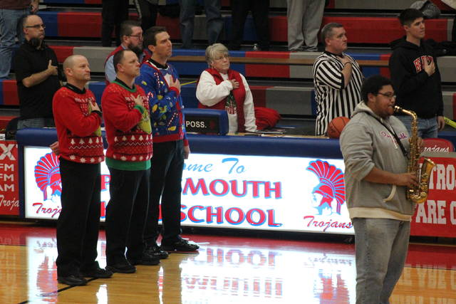 The referee crew during Saturday night's Portsmouth-West varsity game decided to have some festive fun ahead of tip-off.