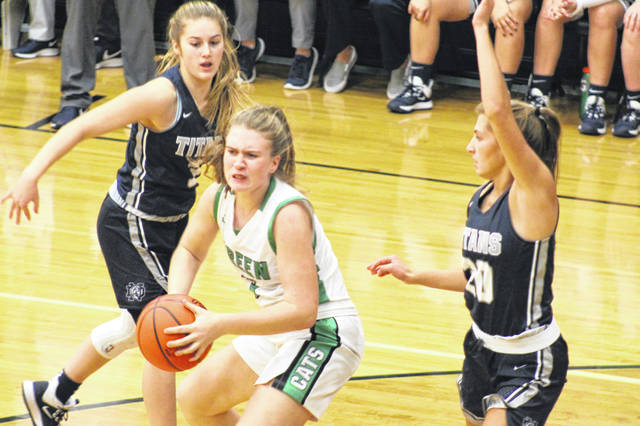 Notre Dame junior Isabel Cassidy (20) defends Green freshman Anna Knapp (3) during the Lady Titans' 71-26 win over the Lady Bobcats on Monday.