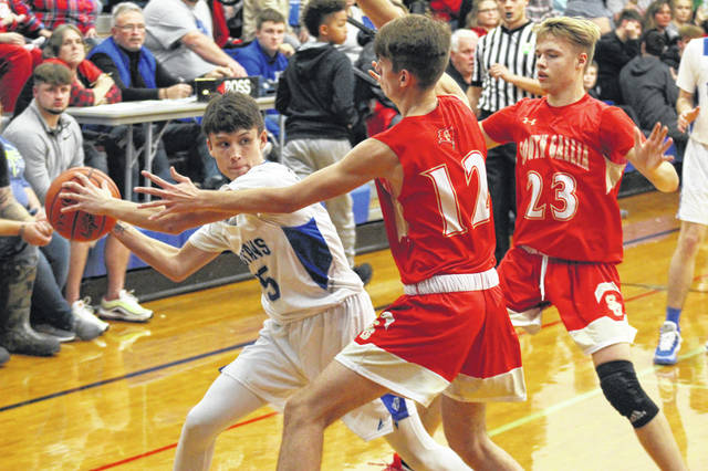East sophomore Andrew Pyles (15) is defended by two South Gallia defenders during the Rebels win over the Tartans in Sciotoville on Monday.