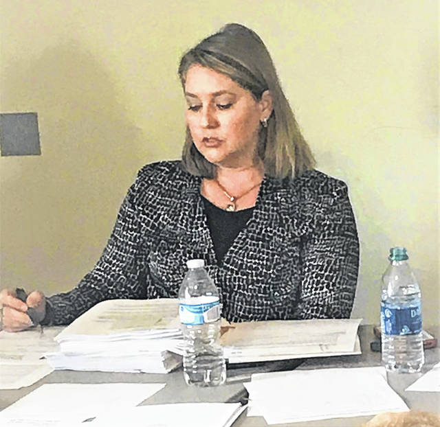 Prior to her suspension, SCCS Director Lorra Fuller sits through a meeting with the SCCS board.