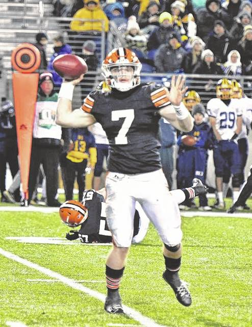 Ironton senior quarterback Gage Salyers (7) attempts a pass during Saturday night's Division V state championship football game at Tom Benson Hall of Fame Stadium in Canton.
