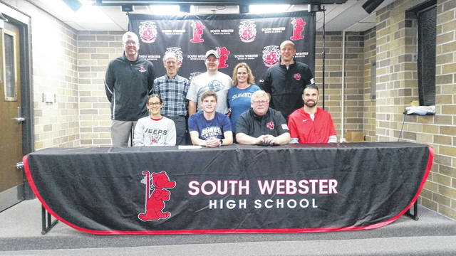 South Webster senior Mason Blizzard (center seated) signed his letter of intent to enroll and continue his cross country and track and field careers at Shawnee State University. Blizzard is planning to major in education upon enrollment at SSU.