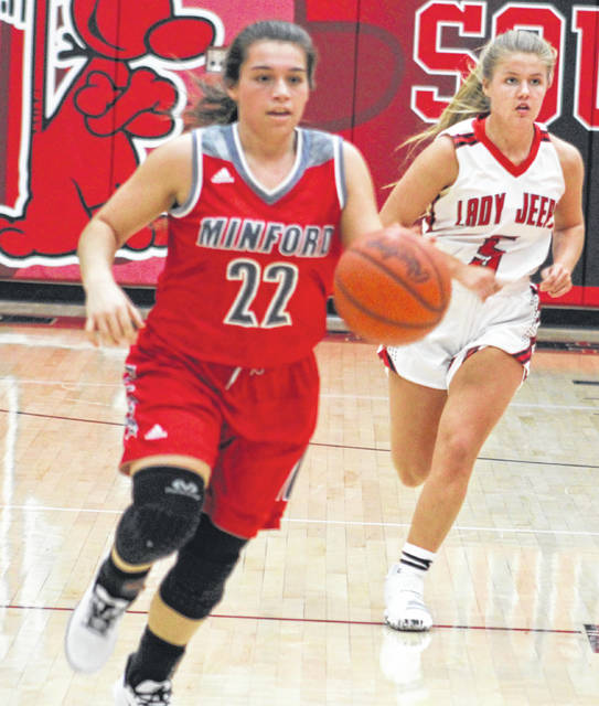 Minford senior Maddie Slusher (22) leads a Lady Falcon fast break ahead of South Webster defender Kenzie Hornikel (5) during Thursday night's Southern Ohio Conference Division II girls basketball game at South Webster High School.