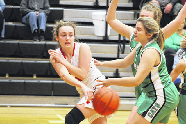 New Boston sophomore Kenzie Whitley (14) finished Thursday's win over Green with a game-high 26 points, 16 points coming in the fourth quarter.