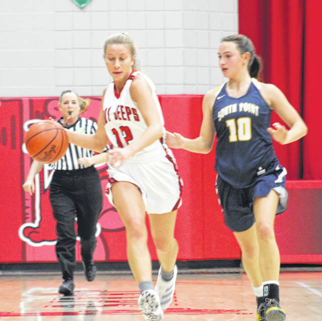 South Webster senior Rose Stephens (12) dribbles against the defense of South Point's Sarah Roach (10) during Friday night's non-league girls basketball game at South Webster High School.