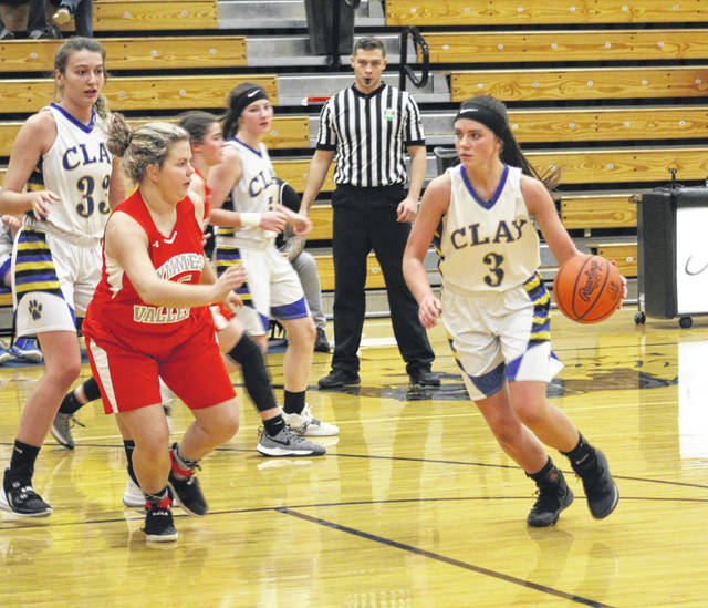 Clay senior Jaelyn Warnock (3), who had a game-high 17 points, dribbles against Symmes Valley defender Kaylee Cade (15) during Monday night's Southern Ohio Conference Division I girls basketball game at Clay High School.