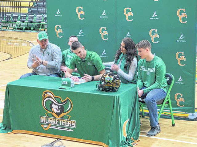 Greenup County senior Eli Sammons signed his letter of intent on Wednesday to enroll and become a member of the football team at Marshall University in Huntington, West Virginia. Sammons finished his senior season as the all-time passing yards leader in northeast Kentucky high school football history and also finishes his high school career as the winningest quarterback in GC history (19 wins). In total, Sammons threw for 7,635 passing yards and 83 passing touchdowns in the Musketeers' air attack. Sammons will be an early enrollee at Marshall under head coach Doc Holliday.