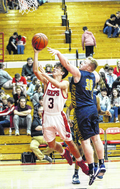 South Webster's Gabe Ruth (3) is fouled by South Point's Brody Blackwell (30) during Friday night's non-league boys basketball game at South Webster High School.