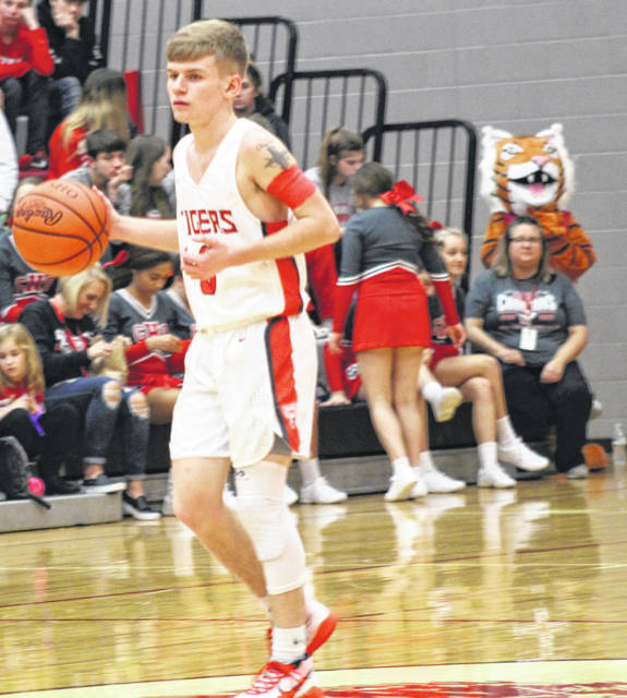 New Boston senior Malachi Potts (0) posted 11 points, five steals, five assists and three rebounds in the Tigers' 68-62 win at Western on Wednesday night in a Southern Ohio Conference Division I boys basketball makeup matchup.