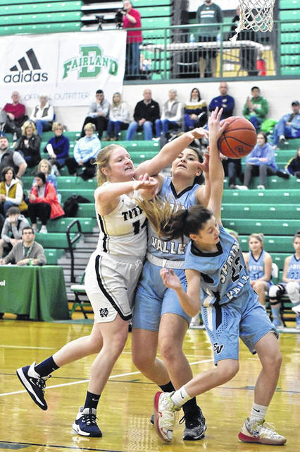 Notre Dame's Claire Detwiller (14) battles Spring Valley's Haile Bailey (22) and Ella Edwards for a rebound during Saturday's girls basketball game as part of the Tri-State Hoops Throwdown at Fairland High School.