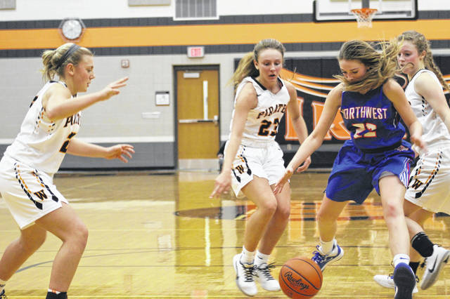 Northwest's Ava Jenkins (22) is surrounded by Wheelersburg's Lauren Jolly (right), Kaylee Darnell (23) and Makenna Walker (left) during Thursday night's Southern Ohio Conference Division II girls basketball game at Wheelersburg High School.